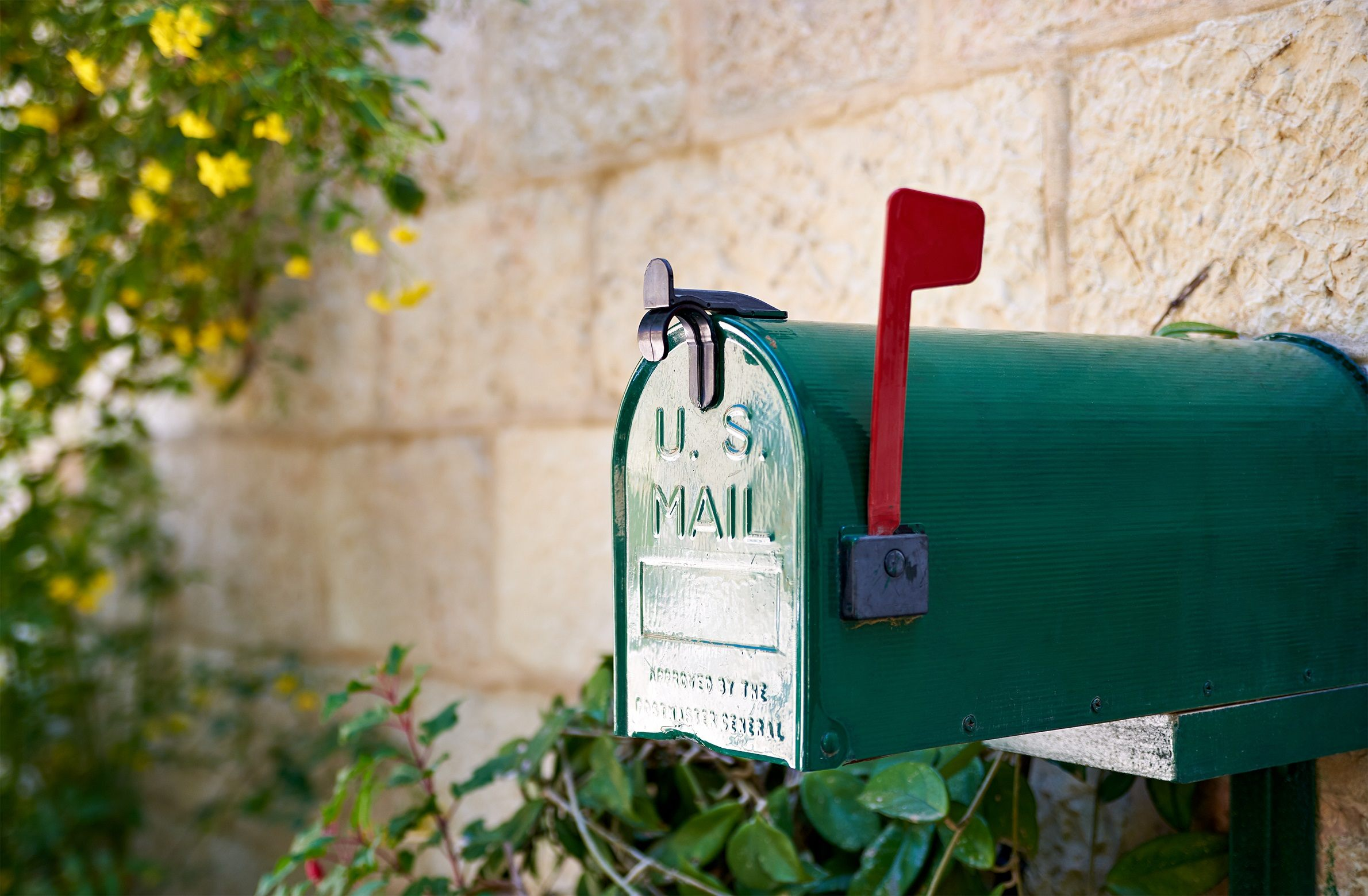 Green mailbox with red flag