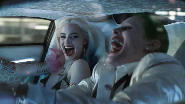 Harley Quinn and the Joker cackling and driving in a car in 'Suicide Squad'.
