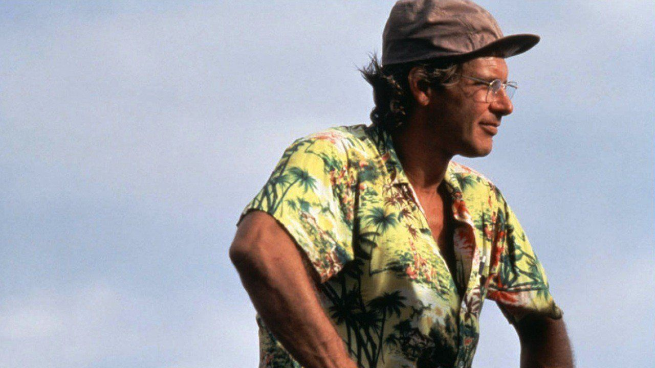 Harrison Ford wears a Hawaiian shirt and a baseball hat as Allie Fox in The Mosquito Coast