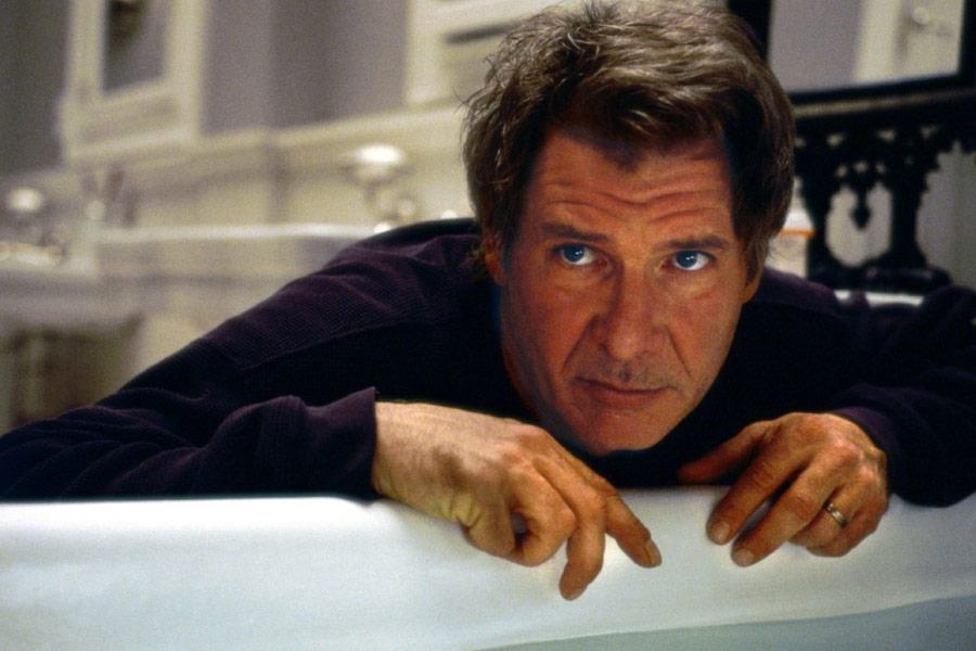 Harrison Ford leans over the edge of a bath tub in Norman Spencer in What Lies Beneath