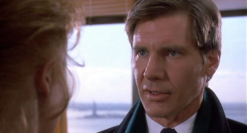Harrison Ford looks at a woman as Jack Trainer in Working Girl