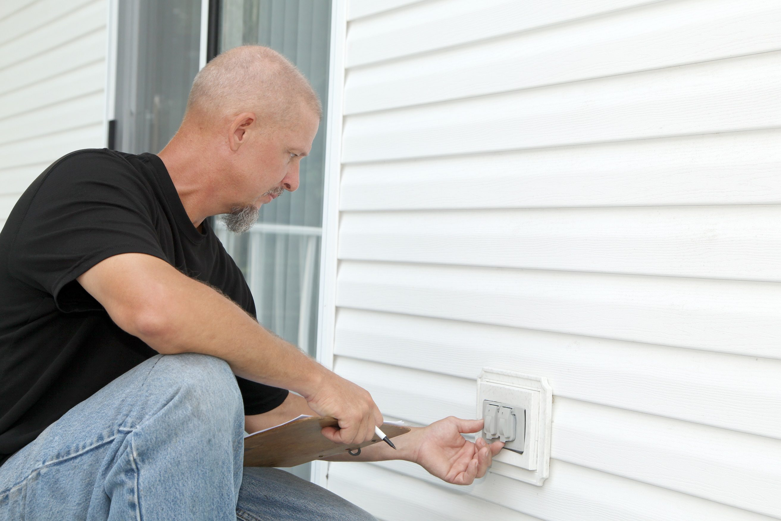 Contractor inspecting outlets