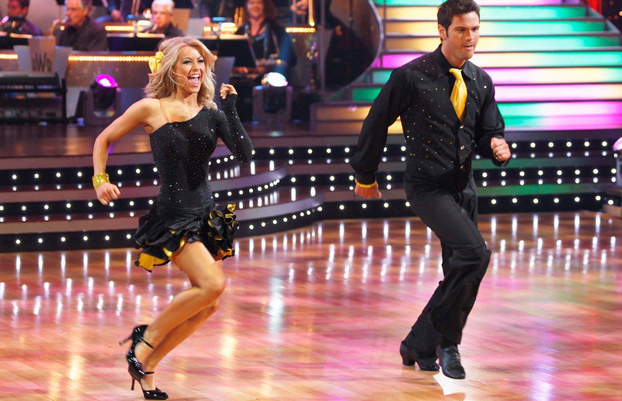 Julianne Hough and Chuck Wicks dance in black and yellow costumes