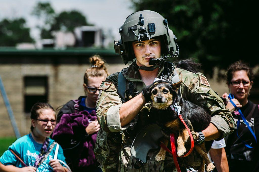 military helping people