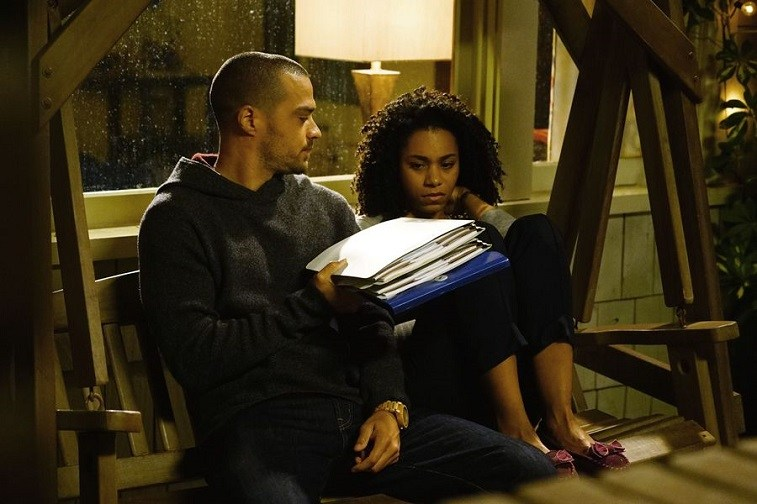 Jackson and Maggie talking on a porch swing on Grey's Anatomy