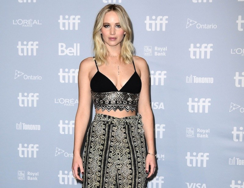 Jennifer Lawrence wears a crop top and matching pants while at an event
