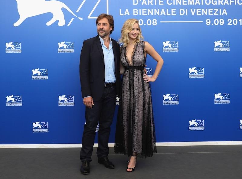 Jennifer Lawrence poses in a black dress alongside mother! costar Javier Bardem