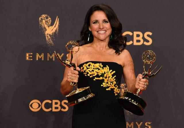 Julia Louis-Dreyfus at the Emmys, holding two awards.