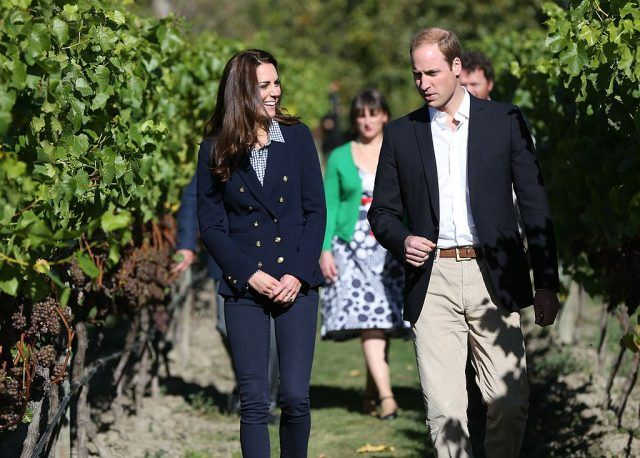Kate Middleton and Prince William walking through a winery.