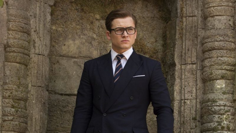 Taron Egerton wears a suit in Kingsman: The Golden Circle