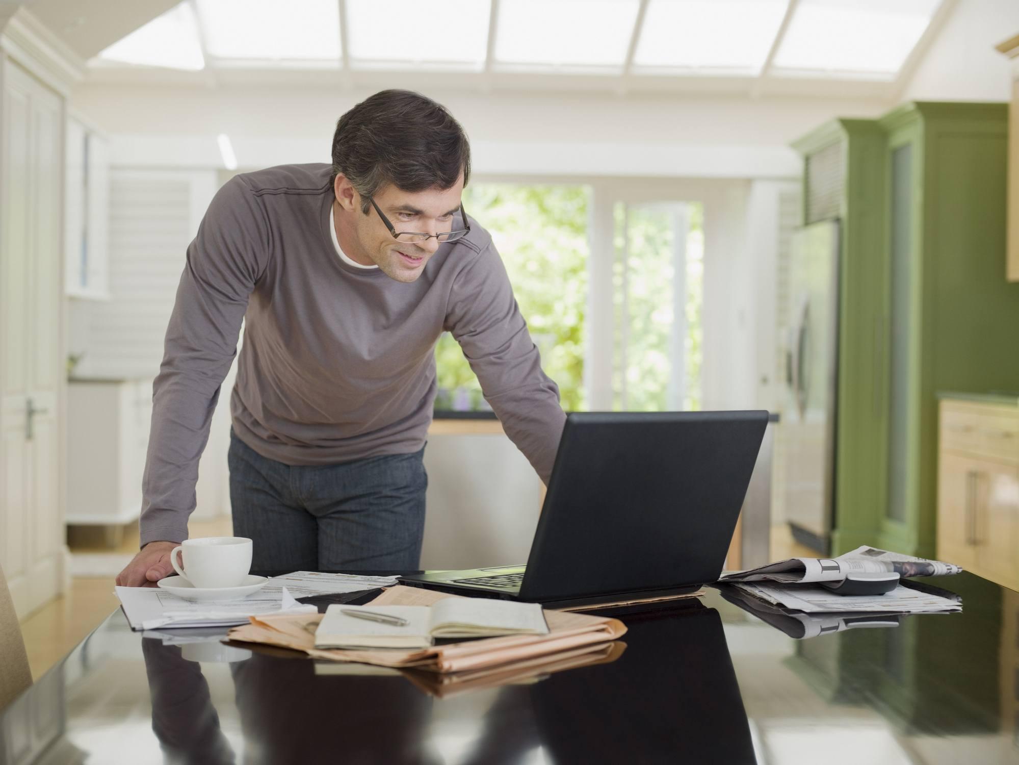 Man at kitchen desk