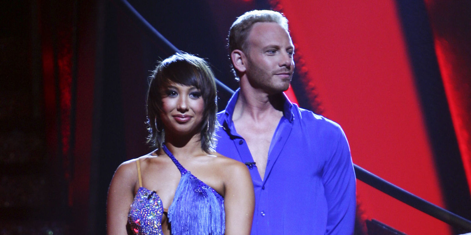 Cheryl Burke and Ian Ziering stand next to each other in colorful outfits on Dancing with the Stars