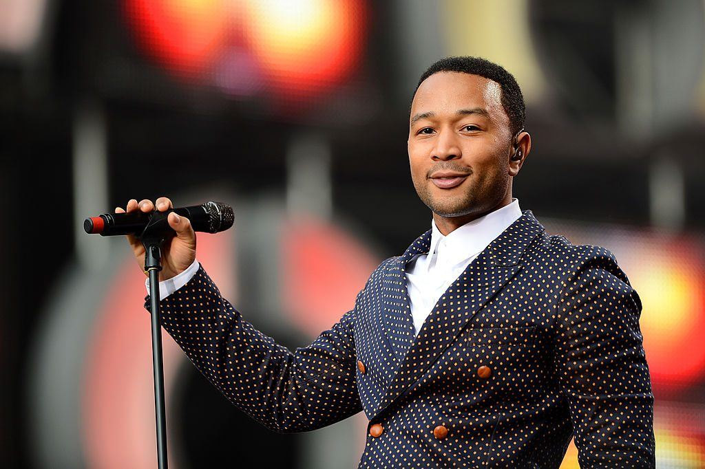 John Legend performs on stage in 2013