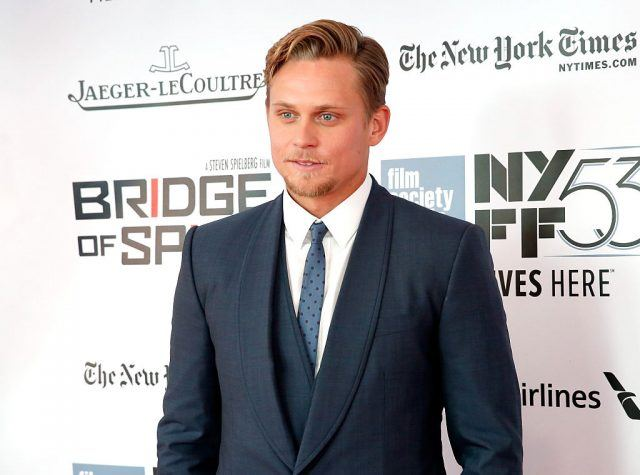Billy Magnussen at the premiere of Bridge of Spies in a blue suit.