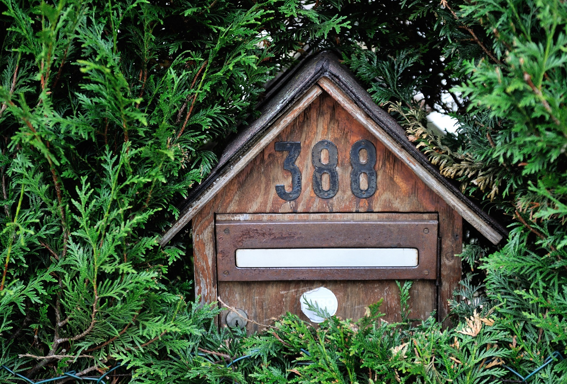 Wooden mailbox with numbers
