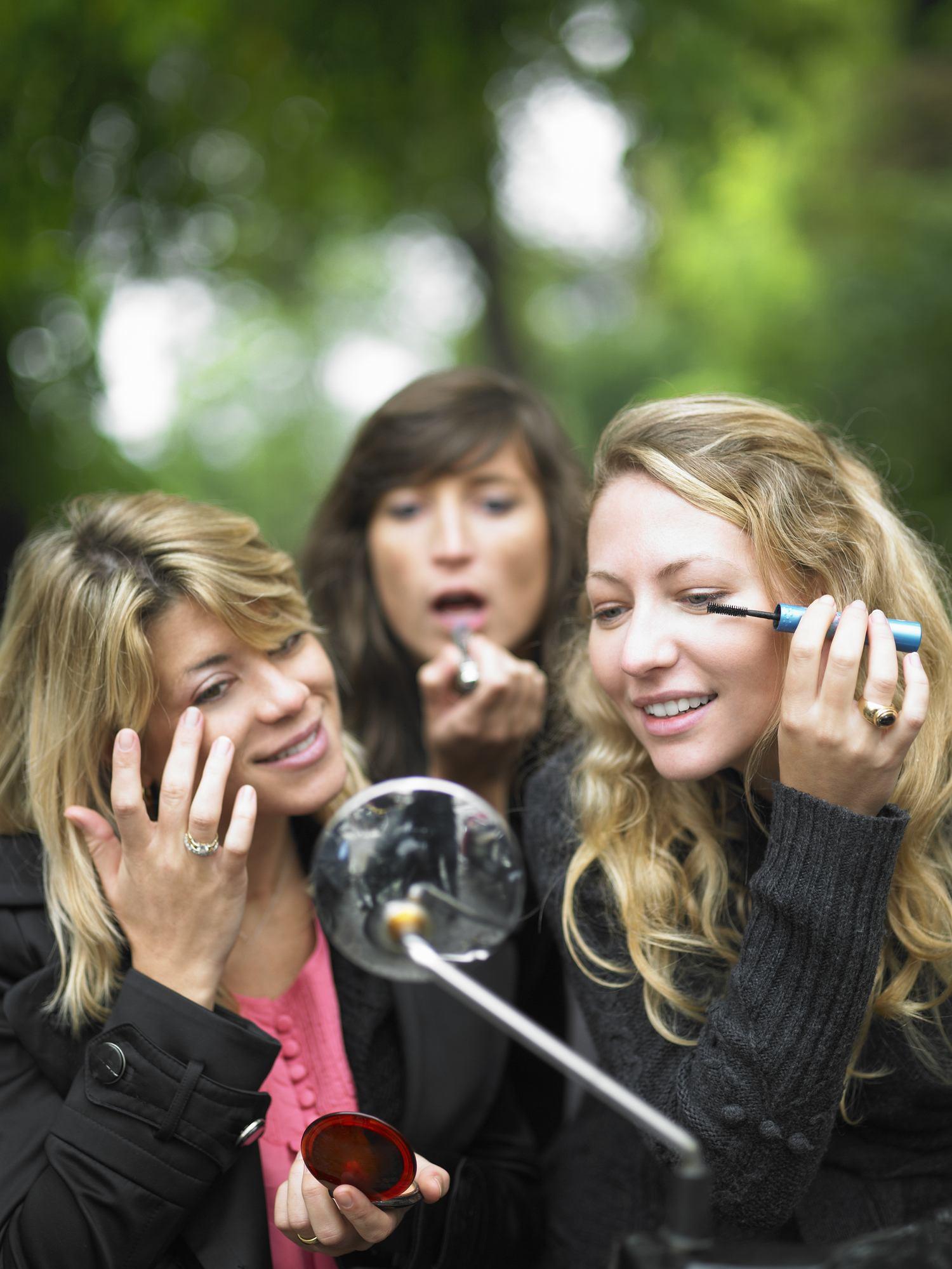 Friends applying makeup