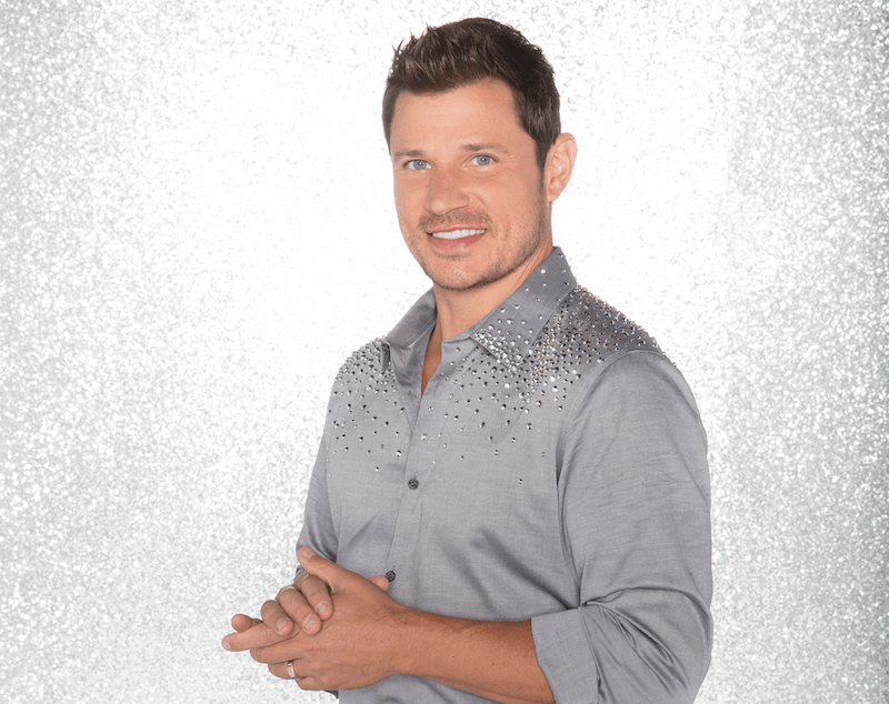 Nick Lachey poses in a silver rhinestone shirt