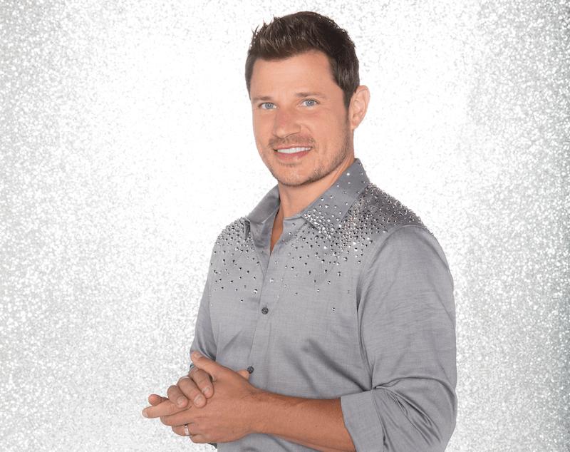 Nick Lachey poses in a silver rhinestone shirt