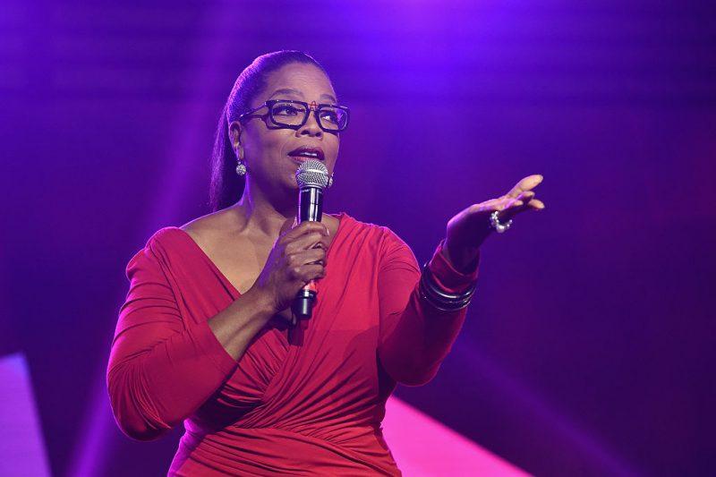 Oprah Winfrey speaking into a microphone