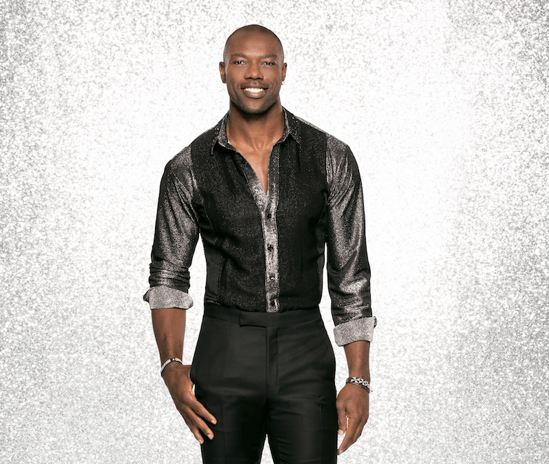 Terrell Owens poses in a silver and black outfit