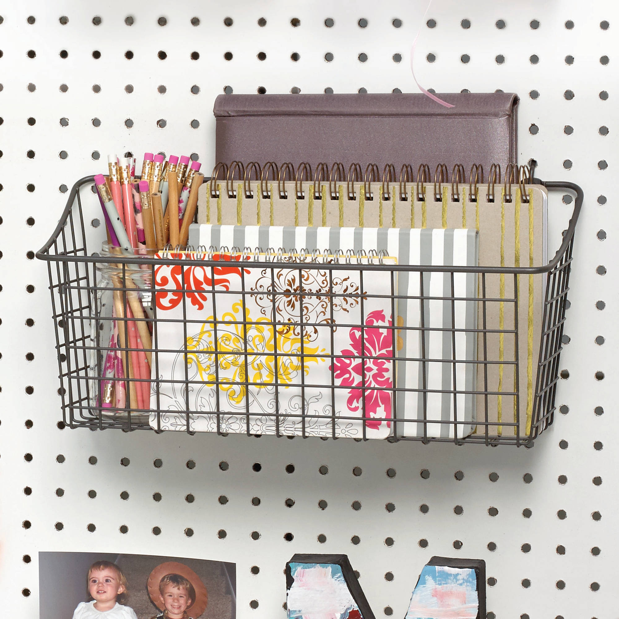 Pegboard with notebooks