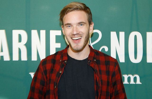 Felix Kjellberg smiling in a red flannel in 2015.