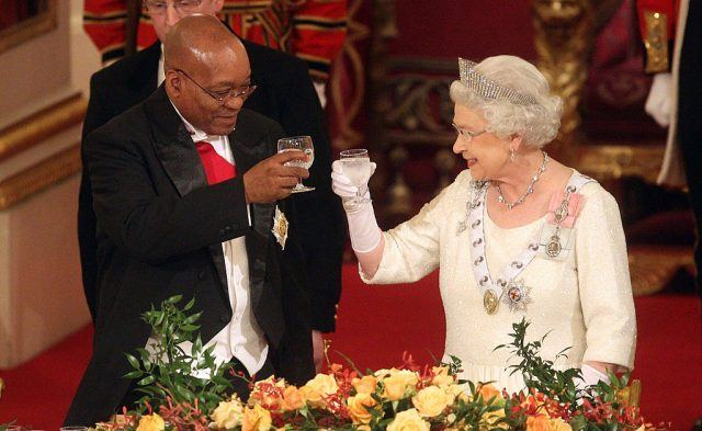 Queen Elizabeth toasts with champagne.