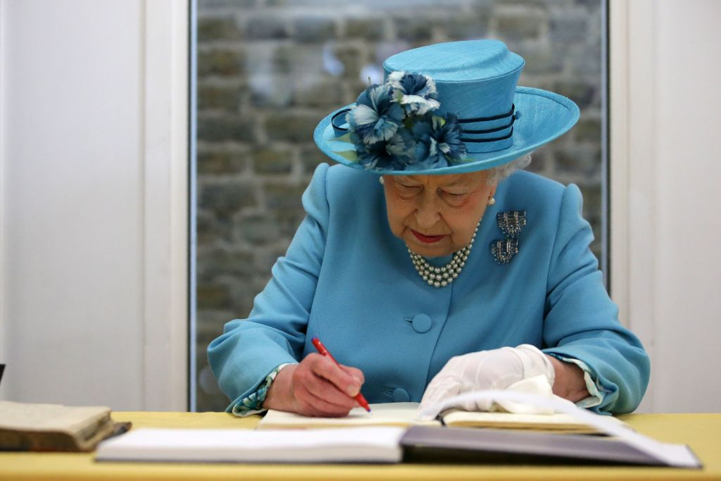 Queen Elizabeth Signing a letter