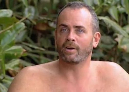 Richard Hatch goes shirtless and looks ahead