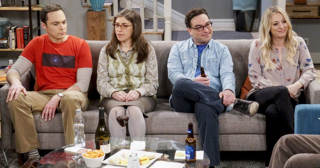 Sheldon, Amy, Leonard, and Penny sitting on a couch on The Big Bang Theory