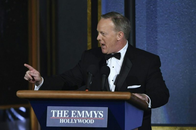 Sean Spicer stands behind a podium at the Emmys