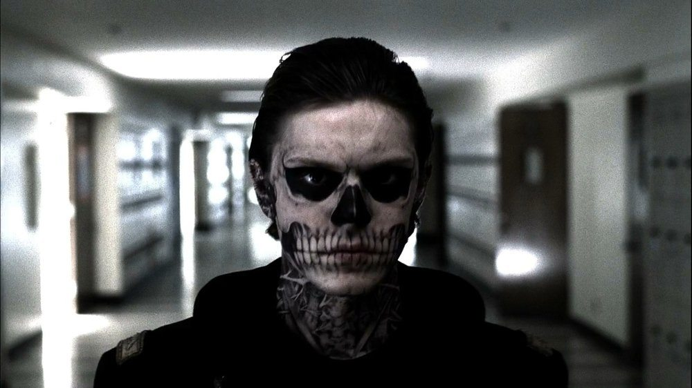Tate in skull make up walking through a school hall