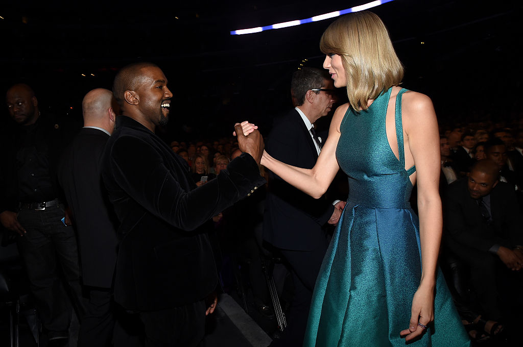 Taylor Swift and Kanye West grab hands