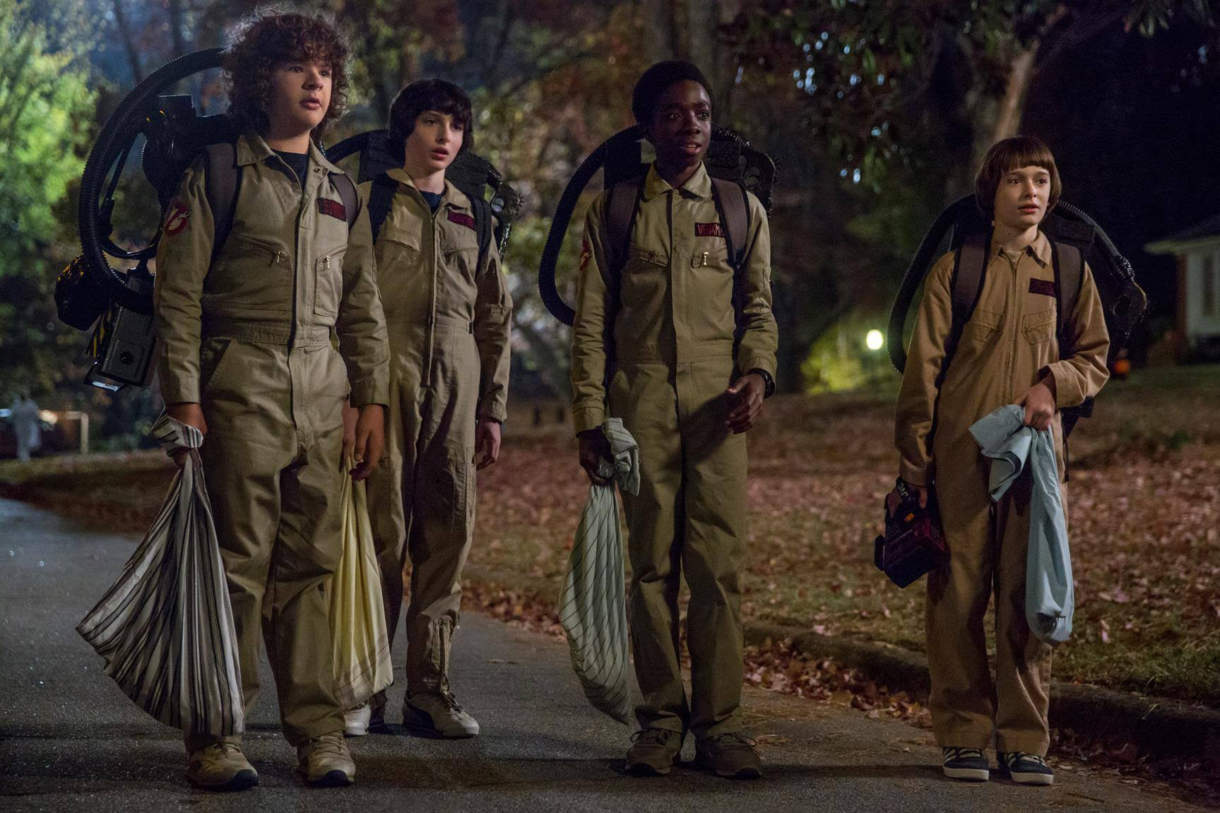 The kids from Stranger Things 2 trick-or-treating as the Ghostbusters