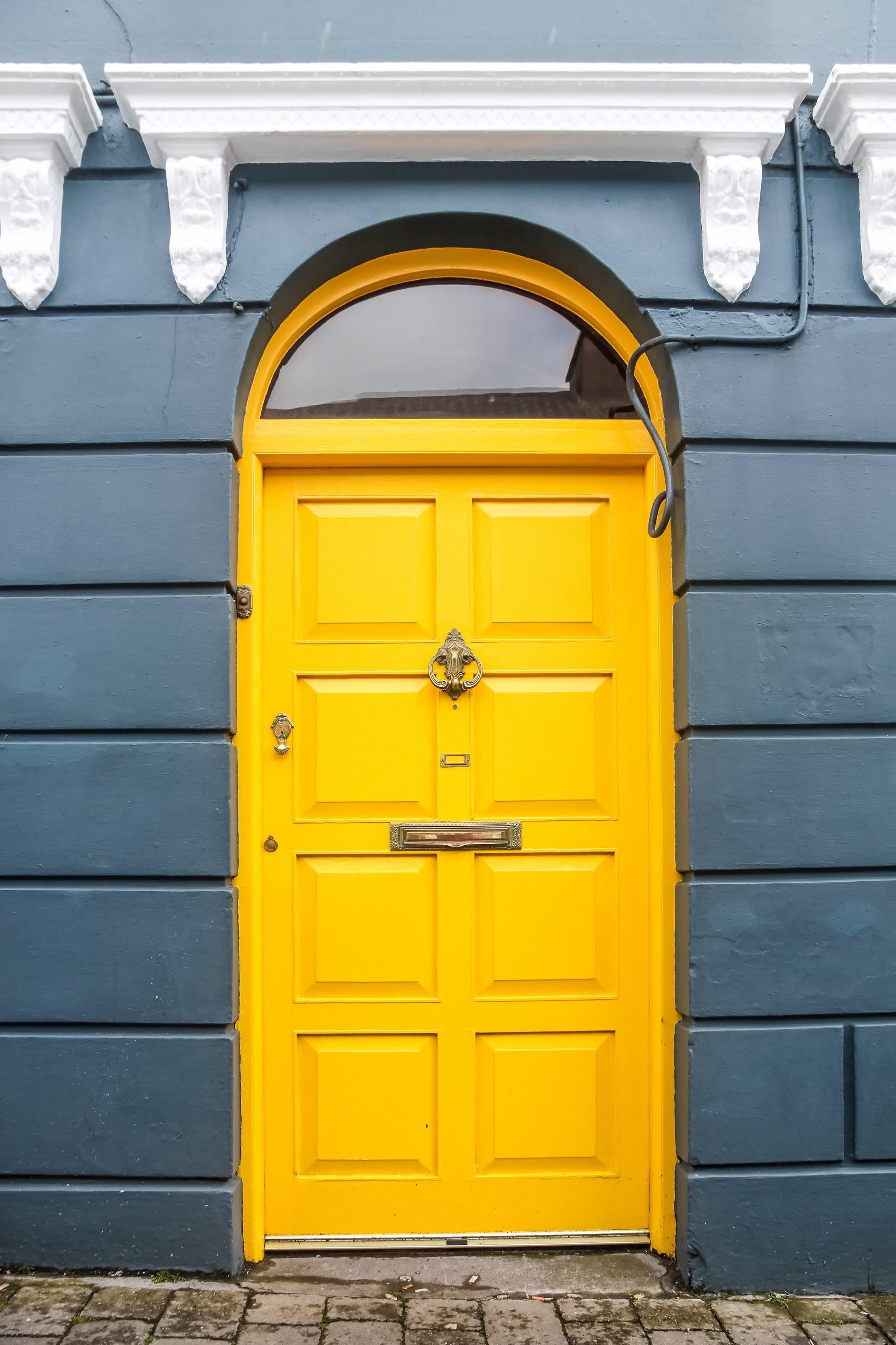 Yellow door on blue house in Ireland