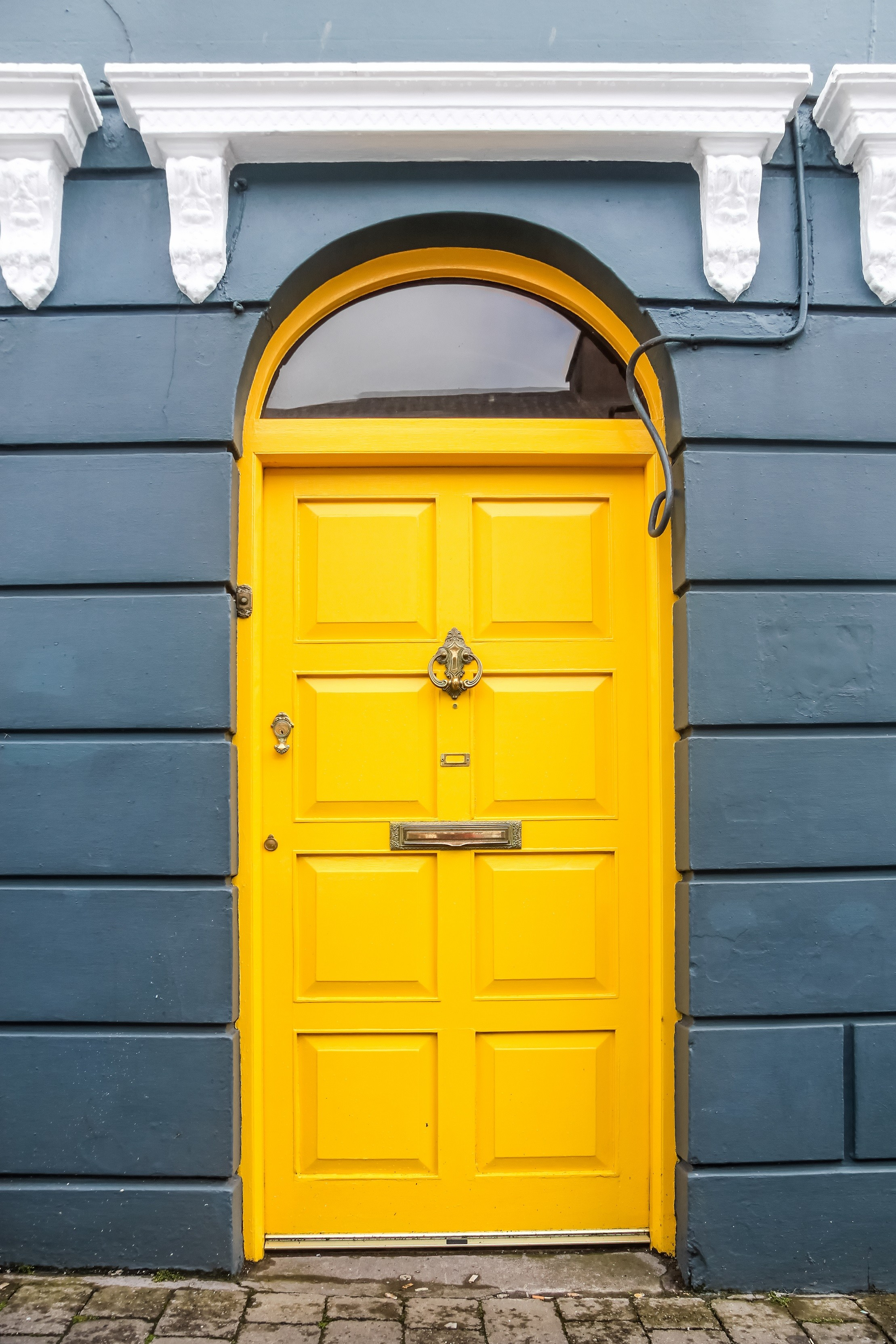 Yellow door on blue house in Ireland