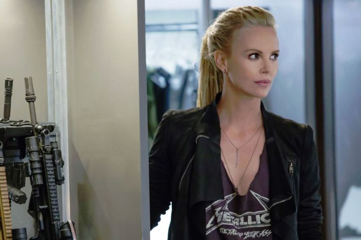 Charlize Theron's Cipher stands in a black jacket in Fate of the Furious