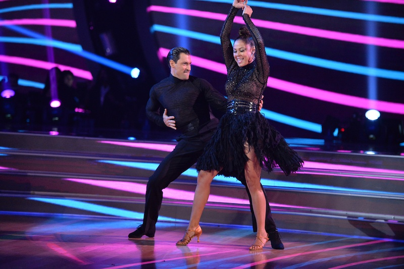 Maks Chmerkovskiy and Vanessa Lachey dancing in black costumes on DWTS
