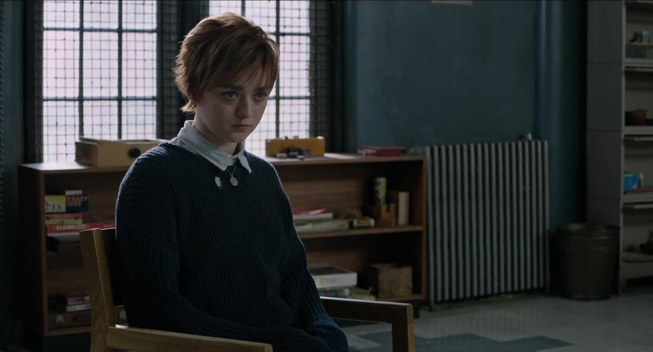 Maisie Williams' Wolfsbane sits in a chair and stares ahead in New Mutants