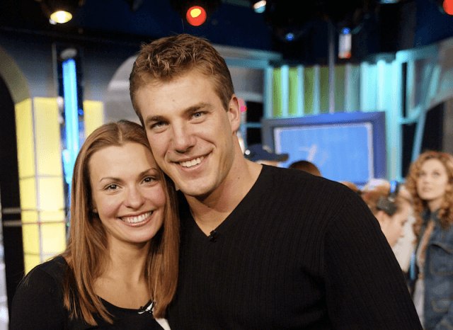 Aaron Buerge and Helene Eksterowicz smiling and holding each other.