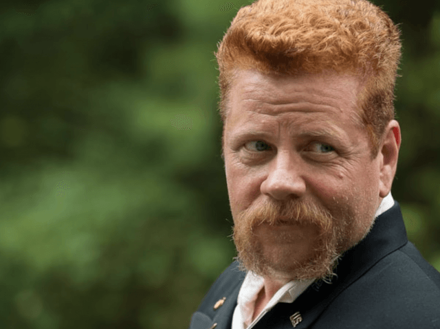 Abraham Ford looking over sideways while standing outside.