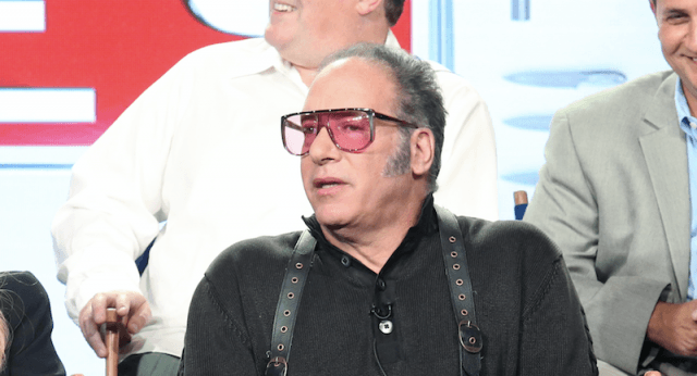 Andrew Dice Clay sitting in an on-stage panel.