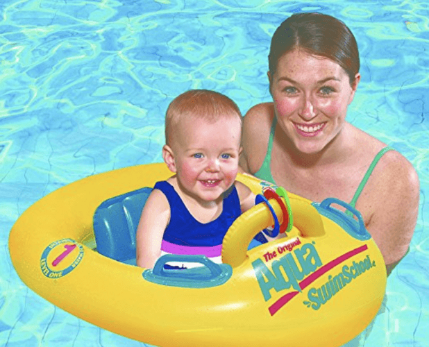 A mother seen with her child on a toy float.