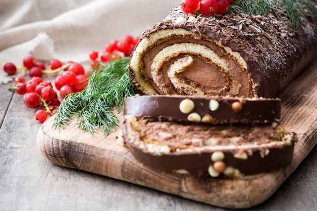 A chocolate yule log on a wooden board.