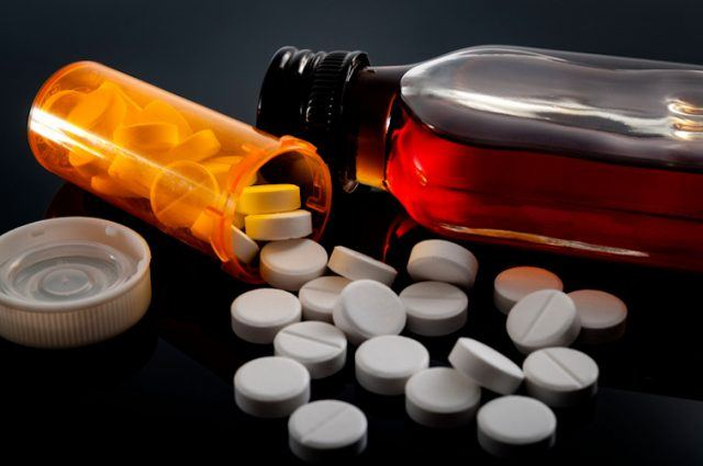 Barbiturates and other medicine on a dark background.