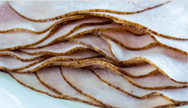 Black Forest Ham slices laid on top of each other.