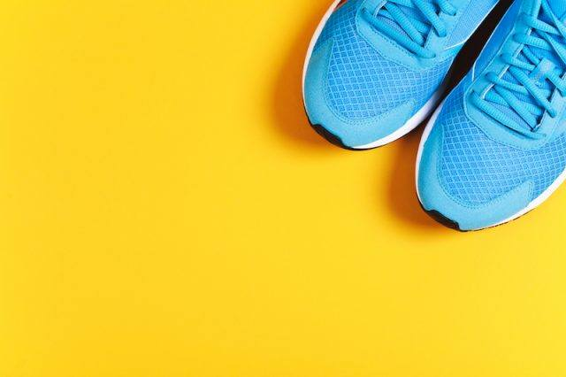 Running shoes on yellow background