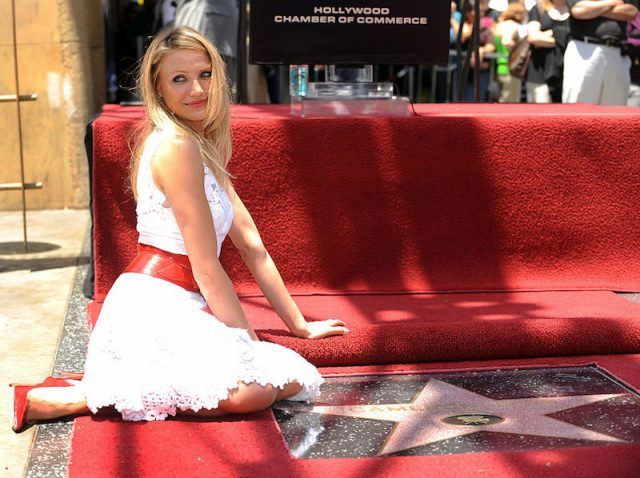 Cameron Diaz poses in front of her star.