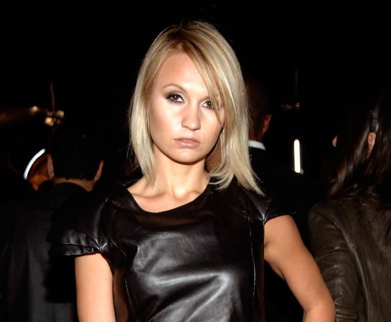Camilla Romestrand poses in a black leather dress