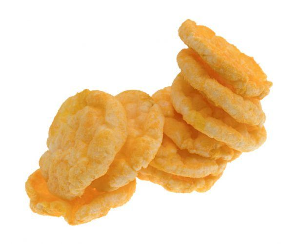 Cheddar rice snacks on a white background.